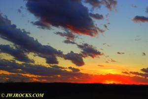 09 Sun Sets Across Field Hwy 19