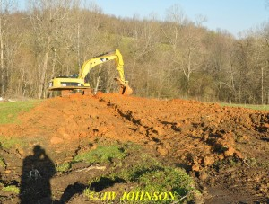 24 Trackhoe Fills In Trench on Hill