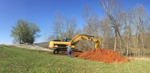 Digging Up Side of Hill in Pasture Near Columbia Mine