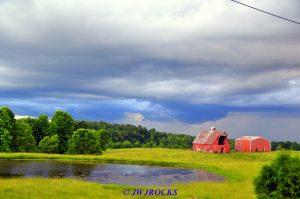 37 Storm Behind Horse Barns